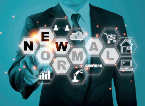 Businessman touching new normal wording with icon such as online shopping social distancing work from home and COVID19.The world is changing to balance it into new normal include business , economy ,
